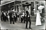 Wedding party marches along Jackson Square.