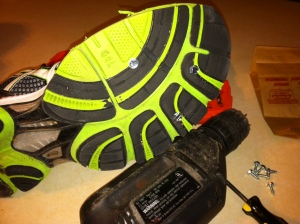 Getting in extra miles during an Iowa winter means not letting a little snow or ice stop you. Here, I've added 5/8th-inch sheet metal screws to the bottom of some of my older running shoes.