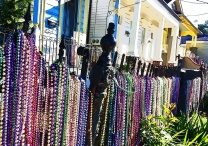 Beads still adorn a fence along Magazine Street a few days after Mardi Gras 2013 in New Orleans.