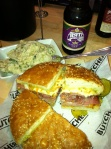 A well constructed and tasty muffaletta, Cajun potato salad and an Abita beer at Cochon Butcher.
