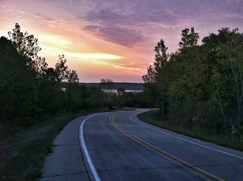 The sun begins to break through the clouds on Mississippi River Road on a September Sunday morning. We've started on long runs before the sun comes up this summer to avoid as much of the heat as possible.