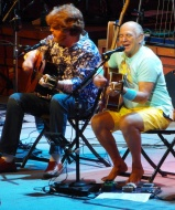 Jimmy Buffet plays during his Phoenix concert on Oct. 24, 2013. Also shown is long-time Coral Reefer Band member Mac McAnally.