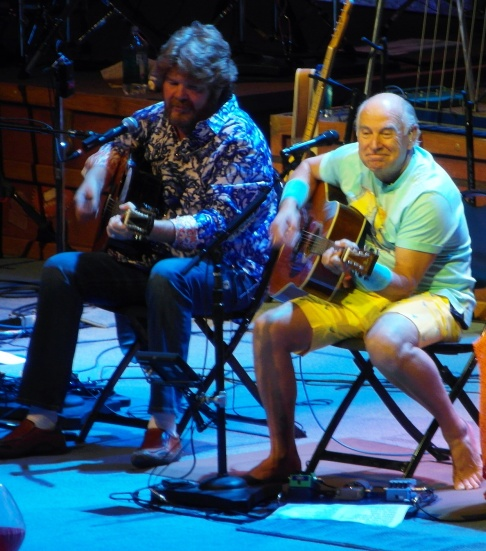 Jimmy Buffett plays during his Phoenix concert on Oct. 24, 2013. Also shown is long-time Coral Reefer Band member Mac McAnally.