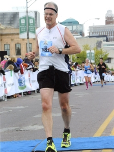 I had a grimace on my face as I crossed the finish line of the Des Moines Marathon in October 2013. I could have run the last two or three miles stronger, but I was happy that I was able to push as hard as I did.