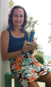 Barb proudly displays her trophy for winning her age group in the End of the World Marathon. Way to go, Barb!