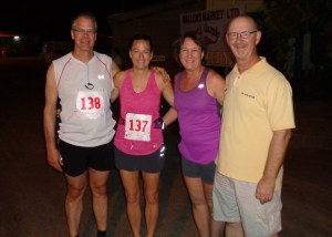 Marathoners Mark and Barb Smidt, from left, take a photo with their own personal support crew, Kristi and Ken Stein, before the start of the race. Thanks, Ken and Kristi, for all your help along the way!