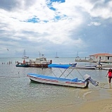 The docks at Placencia, Belize, are quiet on a December 2013 afternoon. A renovated, modern dock is located nearby.