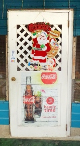 The front door to a restaurant in Santa Cruz, Belize, is decorated for both Christmas and the happy times of rum and Coke. Santa Cruz is about 20 miles north of Placencia, Belize.