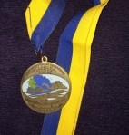 The medal's colors fit perfectly with the Caribbean vibe.