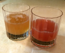 Two different colors of rhubarb stalks and two different sugar solutions resulted in vastly different colored juices. On the left, this syrup used more green-colored rhubarb stalks, much more sugar and yielded much more syrup. On the right, this syrup used more red-colored stalks, used much less sugar and yielded much less juice.