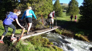 My niece Melissa, left, and several other runners cross a stream.