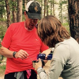 My wife, Barb, pours me some chicken noodle soup at the Foot Bridge Aid Station, mile 18 in the Bighorn 52.